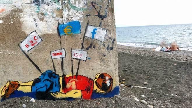 un murales sulla spiaggia di torrione per il piccolo aylan